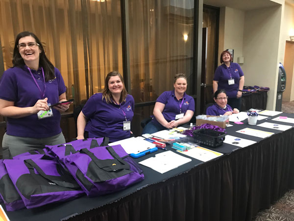 Staff at the convention check-in table