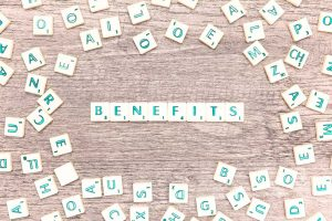 Image of the word Benefits spelled out in tiles on a table