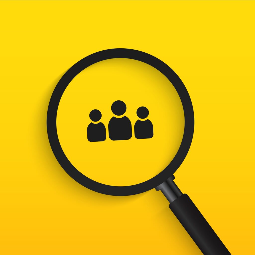 Magnifying glass hovering over three person icons on yellow gradient background
